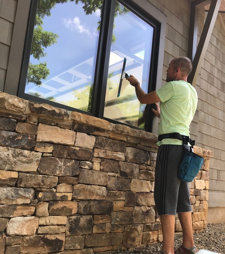 Picture of a man cleaning window: Flat Rock