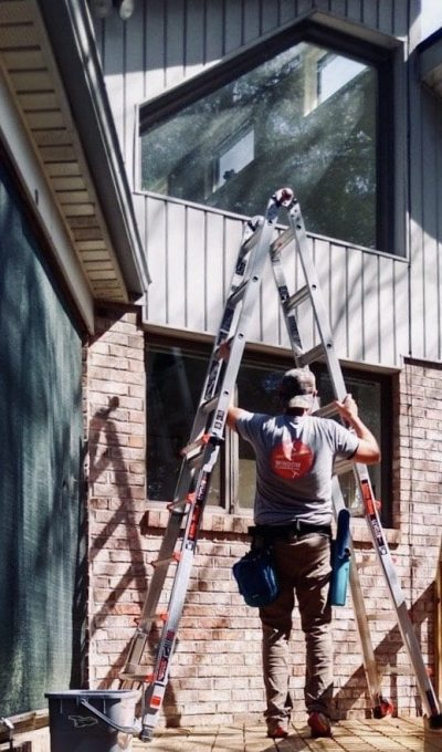 picture of a man holding a ladder