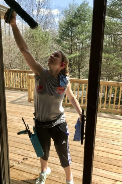 picture of a woman cleaning window: Pandimensional Window Cleaning Company Mills River North Carolina