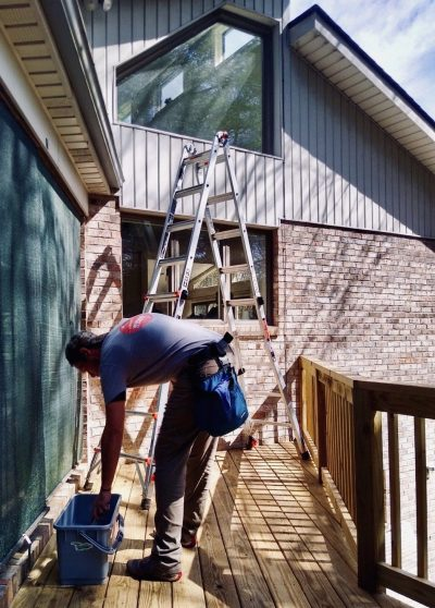 picture of a man with ladder: Pandimensional Window Cleaning Company Mills River North Carolina